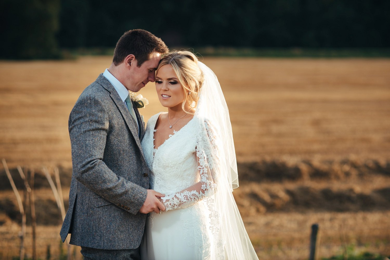 Classic bride and groom hold hands and enjoy a quiet moment at Redbank in Herefordshire