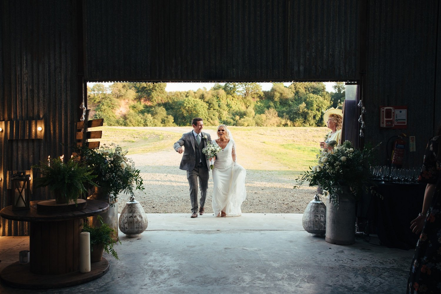 Bride and groom make their entrance into the barn at Redbank in Herefordshire