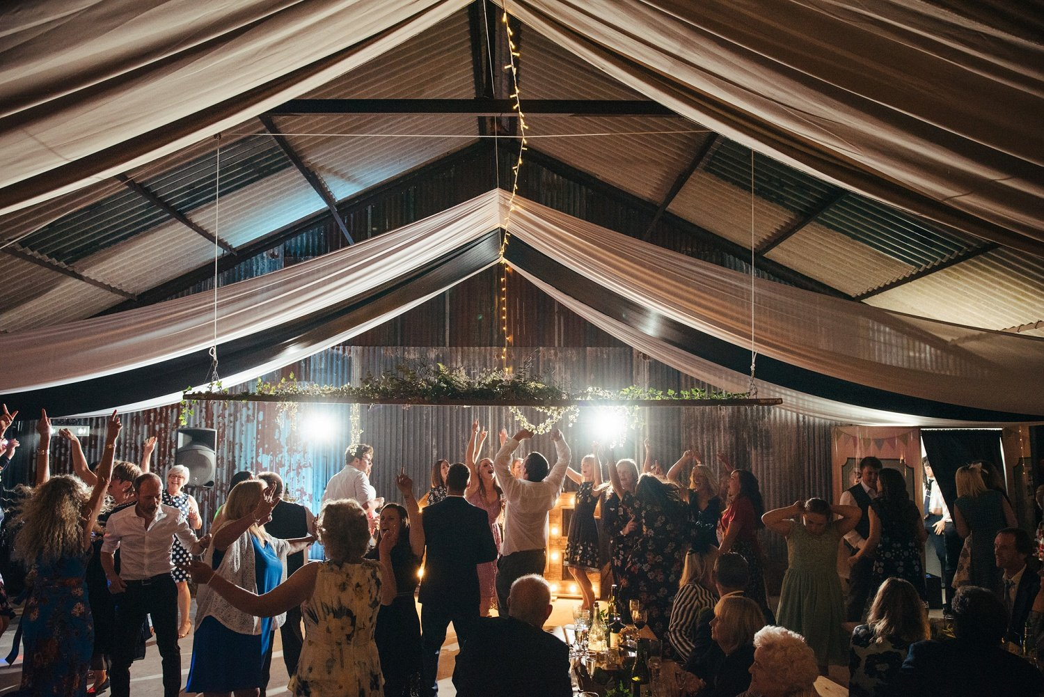 Guests having a great time on the dancefloor at a Barn wedding in Herefordshire