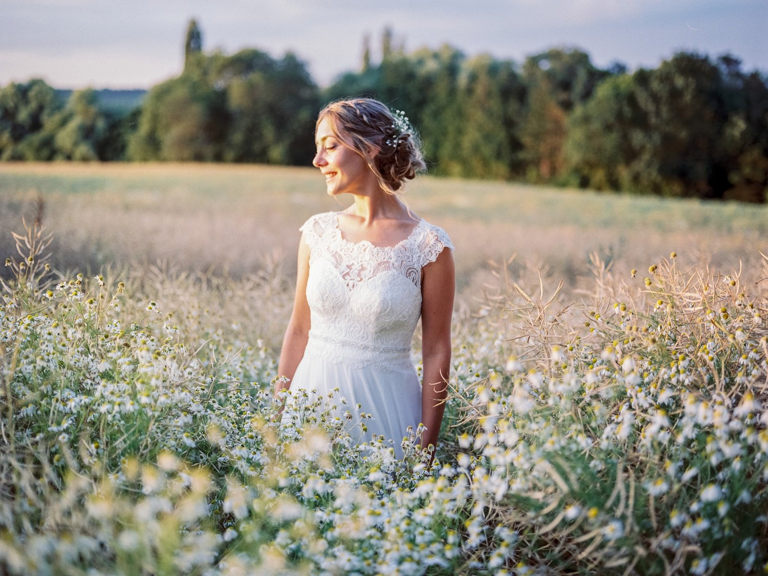 Bride feeling stunning during her portrait photo session as she wear natural makeup