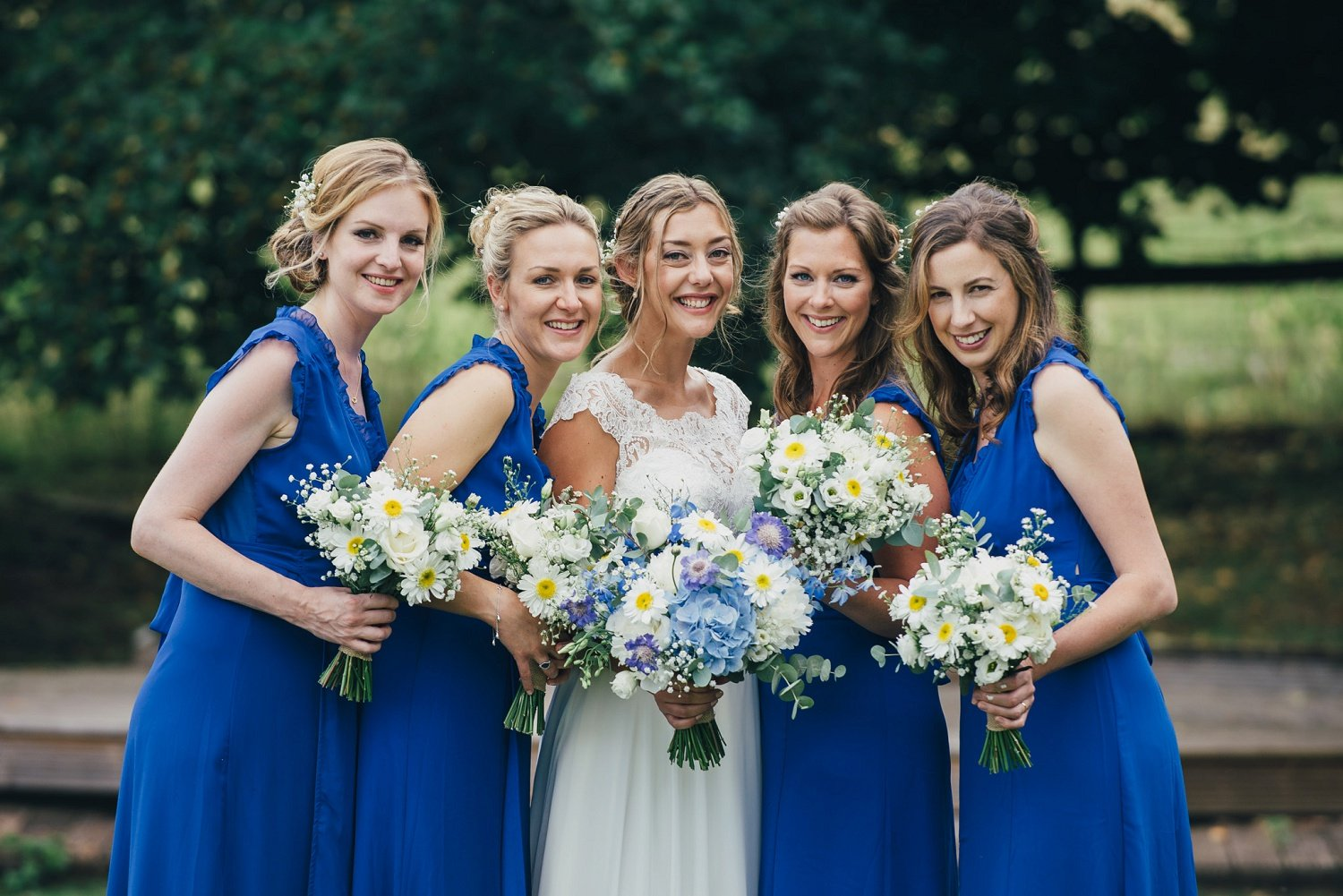 Bride and bridesmaids feeling great after having professional makeup done at the wedding