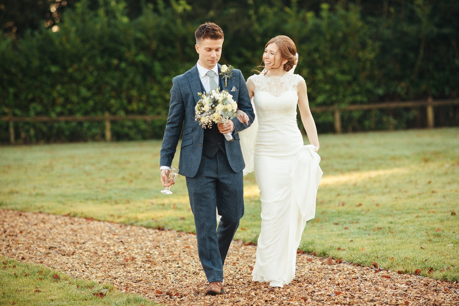 Bride and groom walking together all relaxed at Bredenbury Court