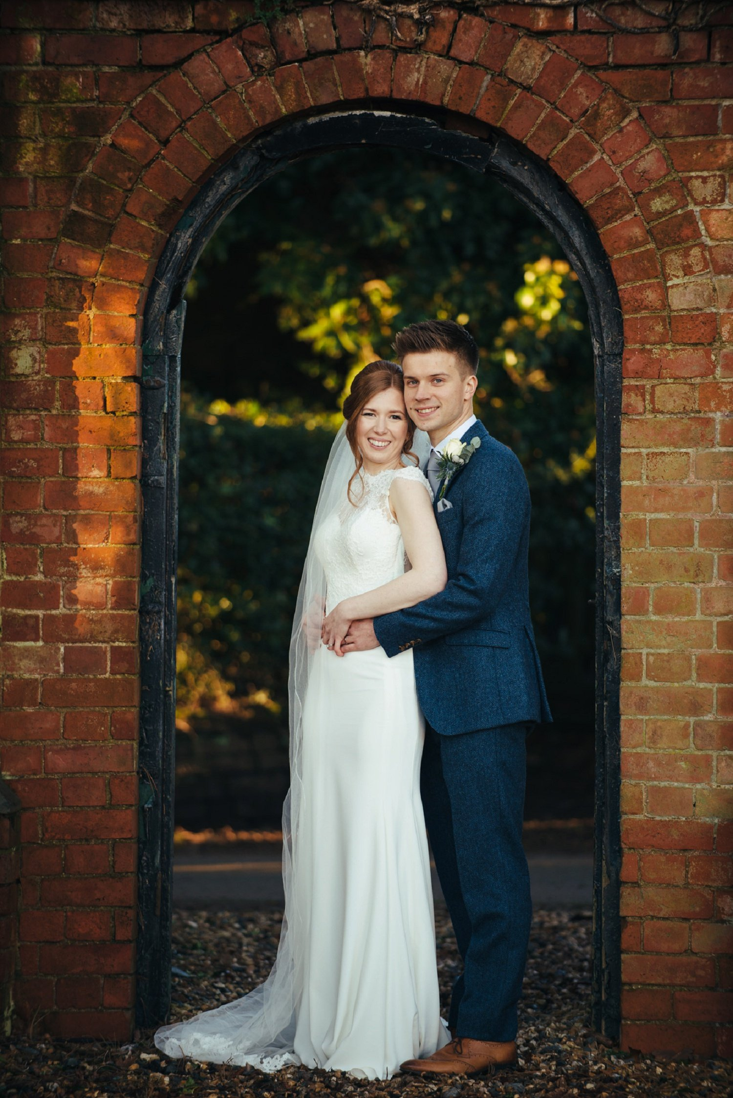 Full body portrait of a bride and her groom in the golden hour at Bredenbury Court Barns in Herefordshire