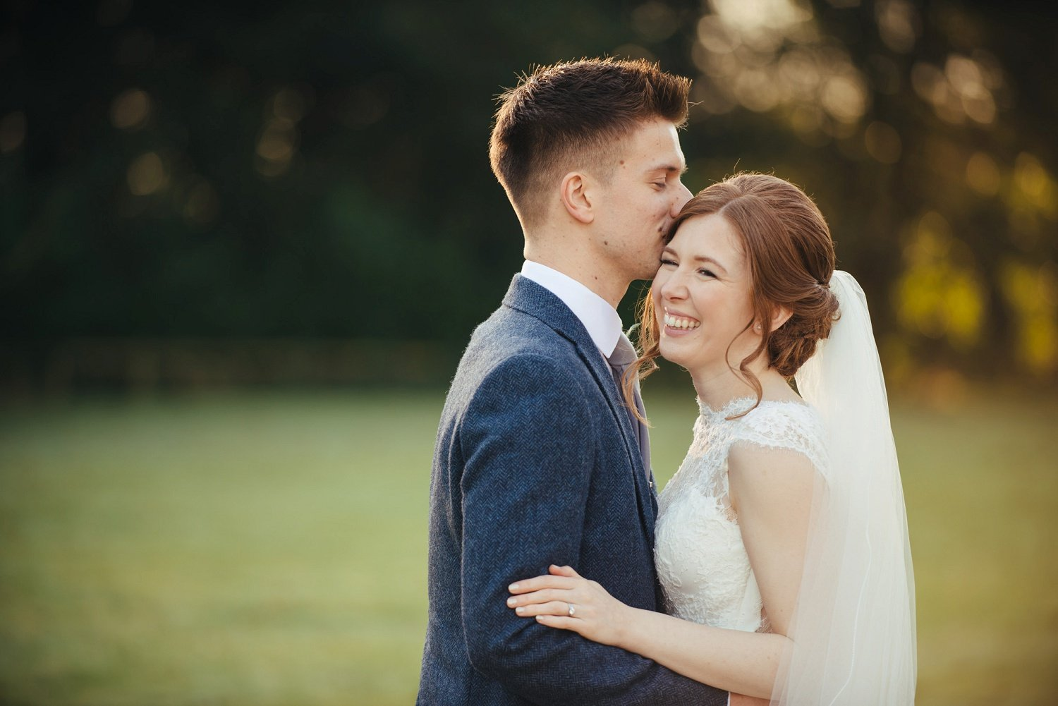 Sweet moment between a bride and gr oom at a barn wedding venue in Herefordshire