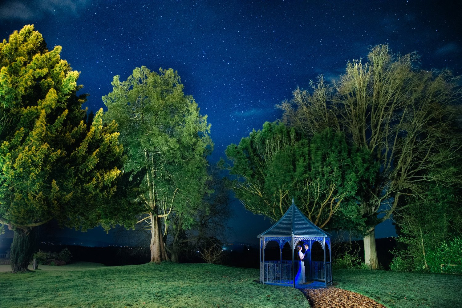 Starry bride and groom portrait by night,the night before New Year's Eve, at Bredenbury Court in Herefordshire