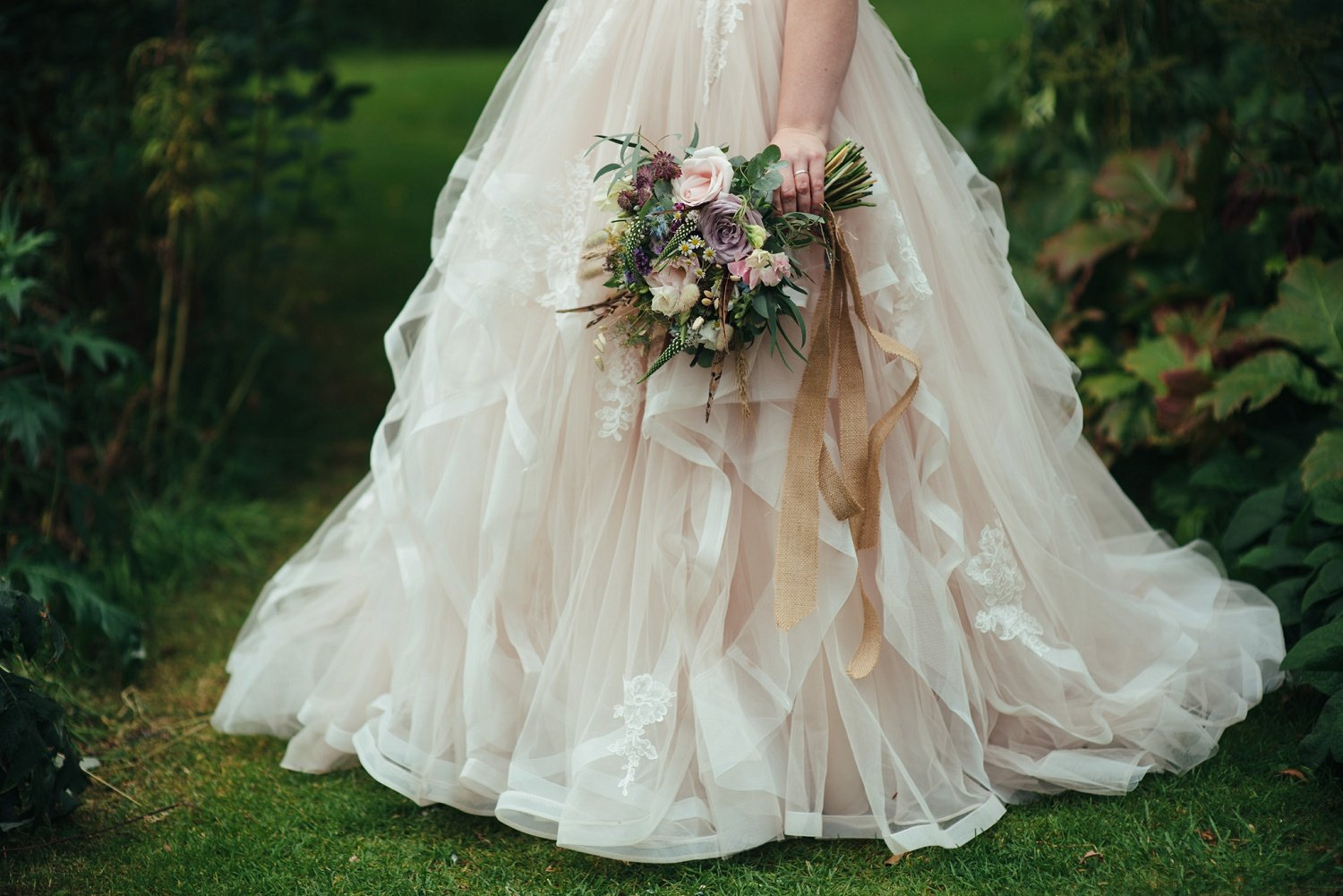 Bridal qouet by Issy and Bella, florist in Herefordshire and a Stella York dress