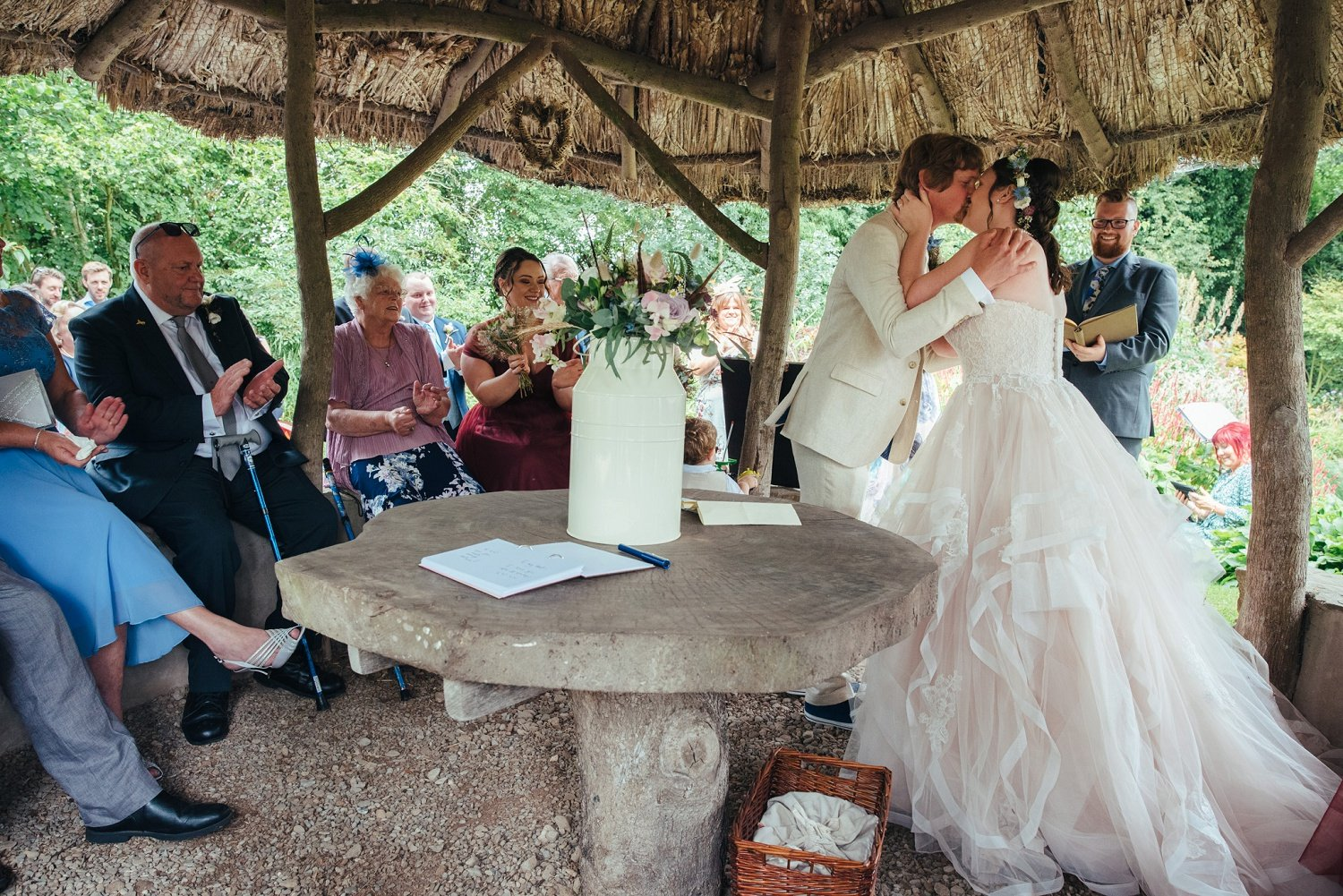 First kiss - alternative outdoors ceremony at Westonbury Mill Water Gardens