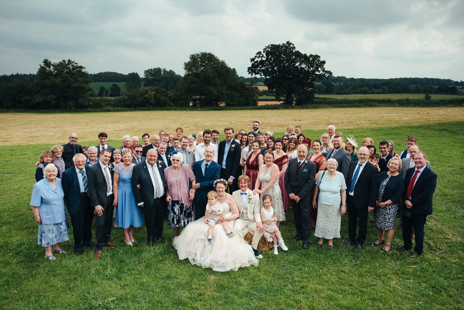 Photo of everyone at the Cider barn in Herefordshire, by Cat Beardsley Photography