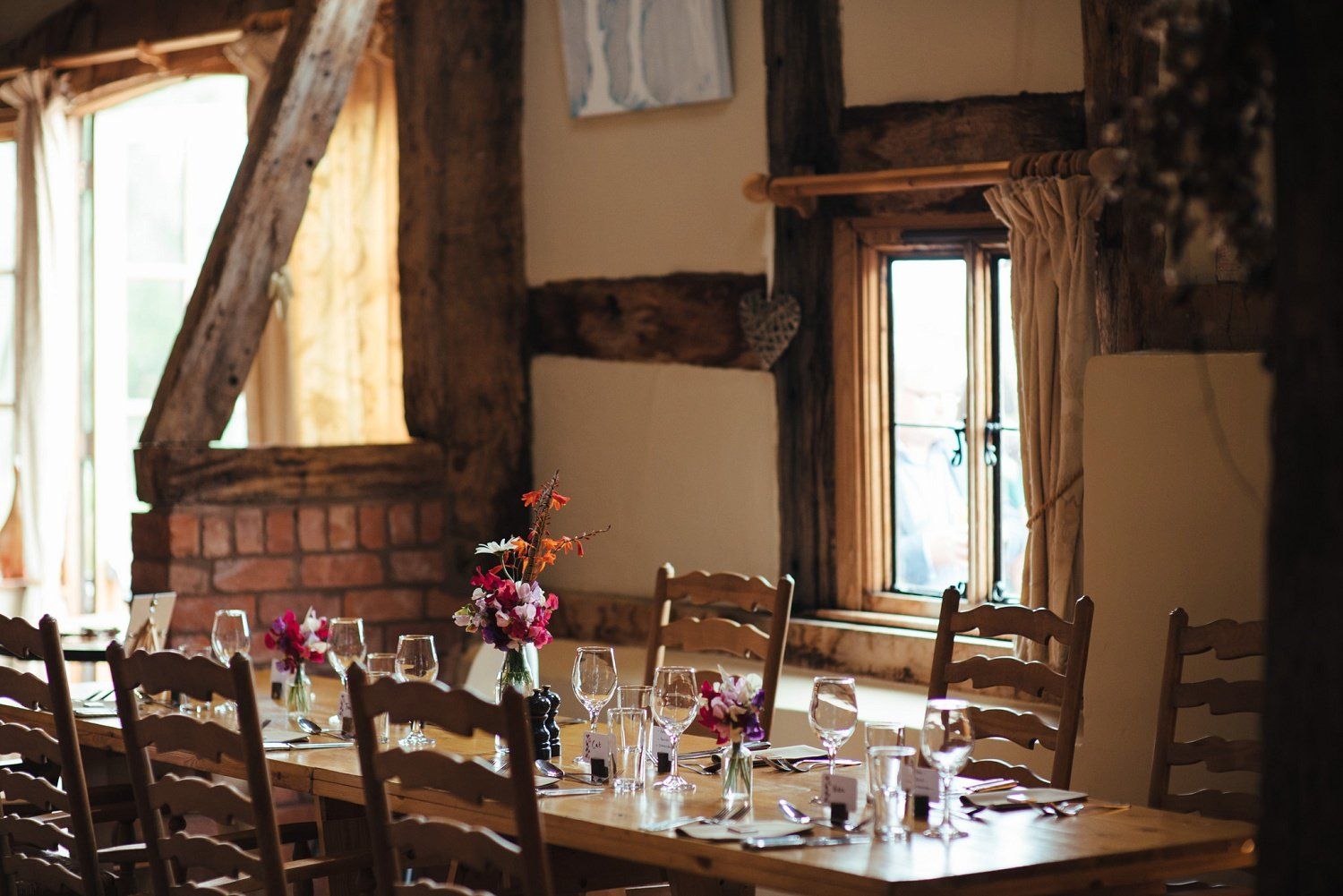 Flower wedding decorations by Issy & Bella at the Cider Barn