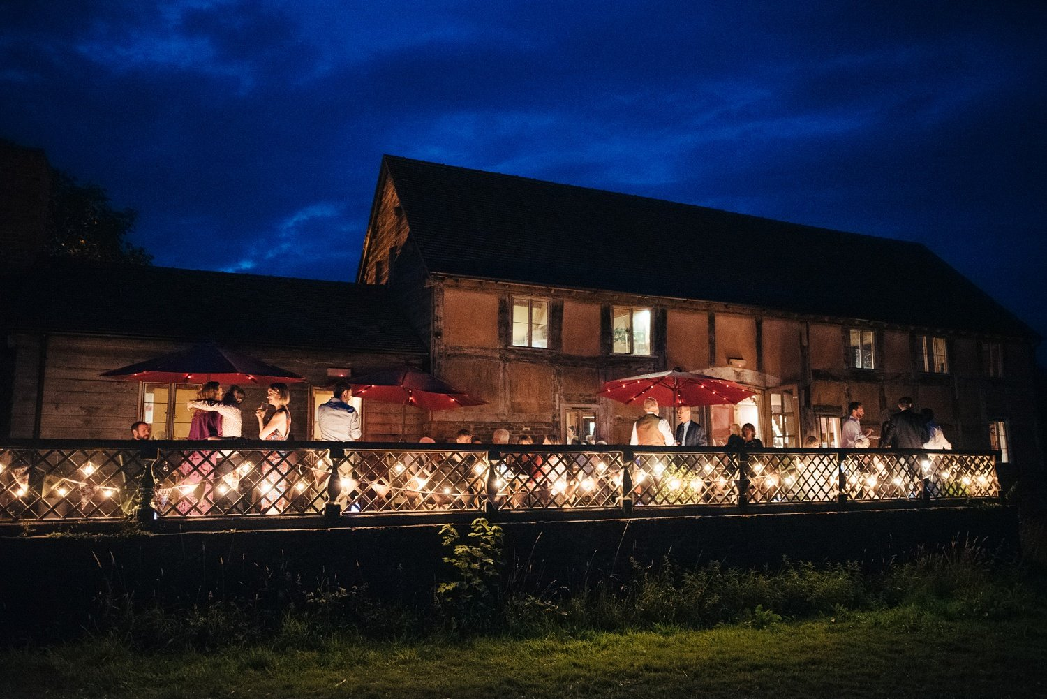 Cider Barn, Herefordshire, by night. End of a wedding
