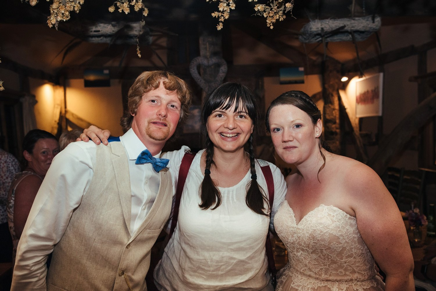 Photo of wedding photographer Cat from Cat Beardsley Photography with one of her couples at the end of the night