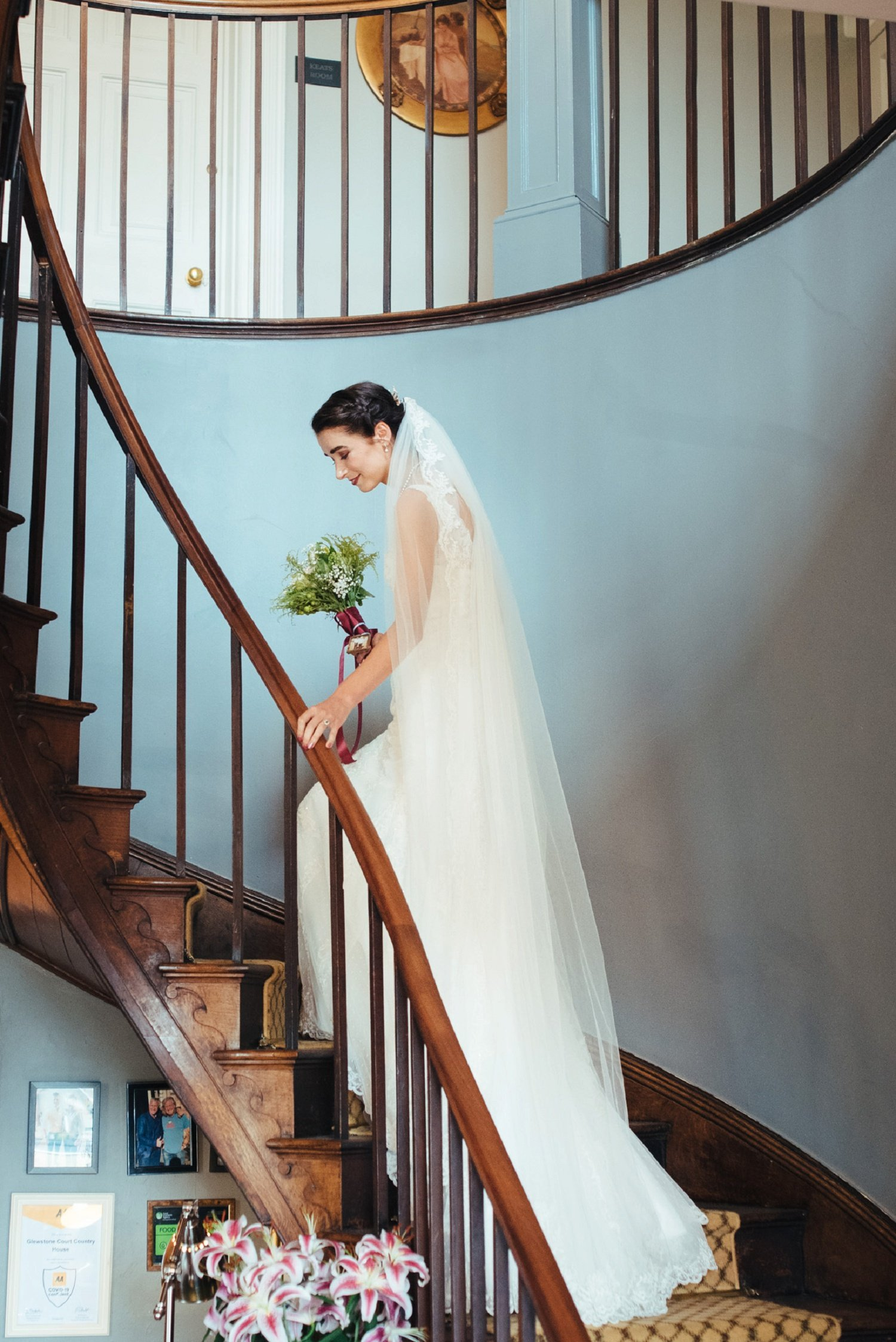 Bride going up the spiral staircase at Glewstone