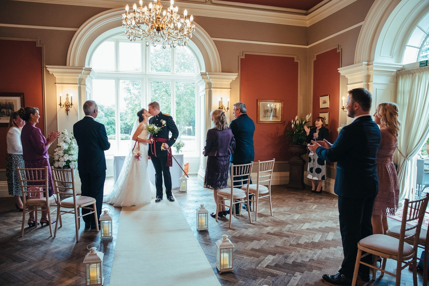 First kiss in the ceremony room at Glewstone COurt in Herefordshire