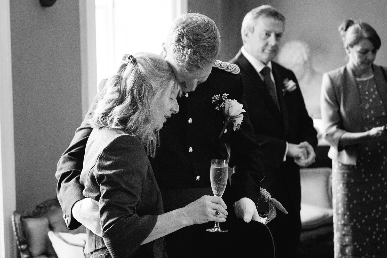 Candid moment between the groom and his mom at intimate wedding in Herefordshire