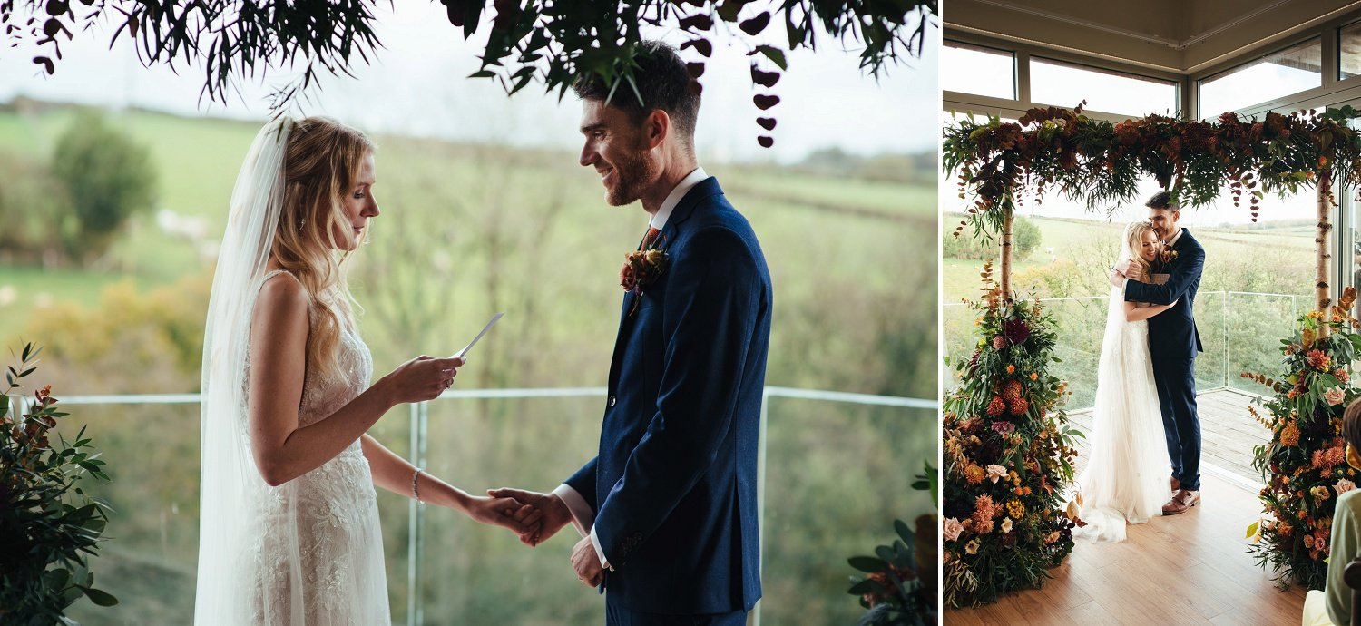 Wedding vows reading under an autumnal floral arh by Jenny Fleur, florist from Herefordshire, UK